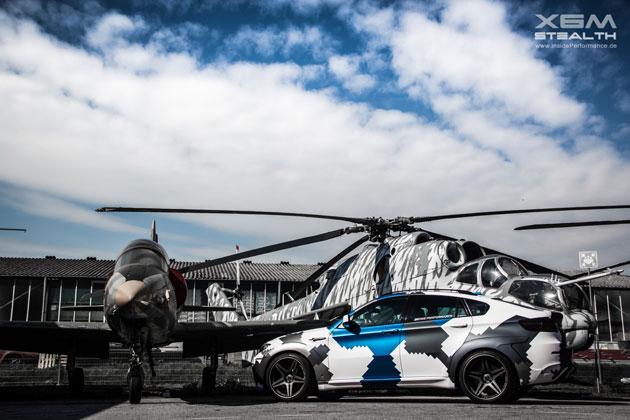 BMW X6m mit dem Mil24 Hubschrauber